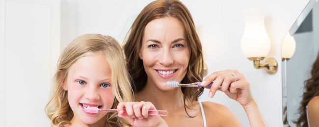 Mother & Daughter brushing teeth